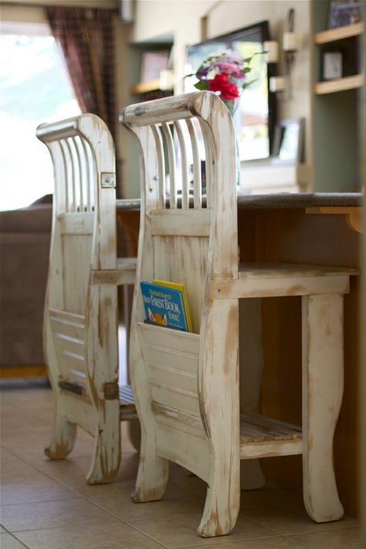 A crib repurposed into bar stools with built-in inserts to hold books