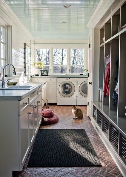 dream house laundry room with family lockers and front loading machines