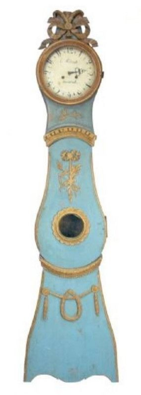 sky blue Swedish clock with ribbon and garland details