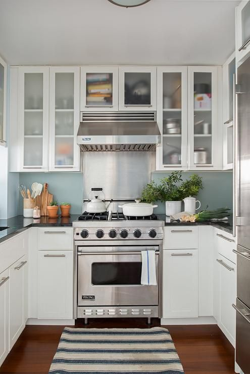 viking range in a white and blue kitchen designed with a
