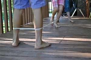 Elastics.  all over the school playground were pairs of legs with elastic around them.