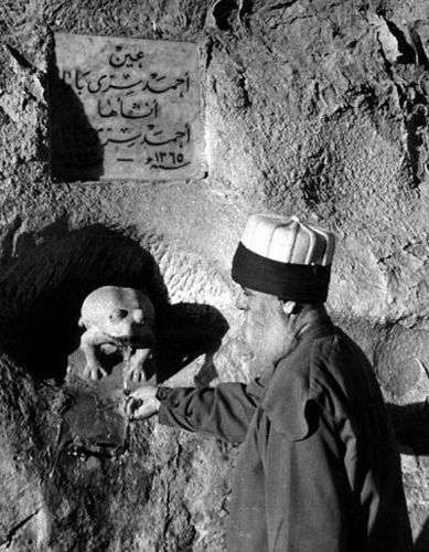 "Press photo by GEORGE ROGER- MAGNUM photos, of Siri [ Ahmed Serri Dede] Ahmad Dede, in the garden of the Bektashi Tekkya ""Monastry"" located at the Jebel Muqattam, on the outskirts of Cairo. The Tekkya, known in Turkish as the Kaygusuz Sultan Tekkya, and in Arabic as Tekkyat Sheikh Abdallah al- Maghaweri [ Meghara= Cave in Arabic]."