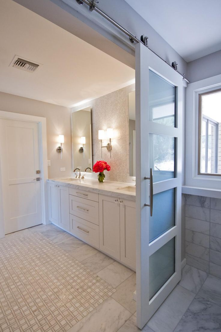 This contemporary master bathroom space features different
