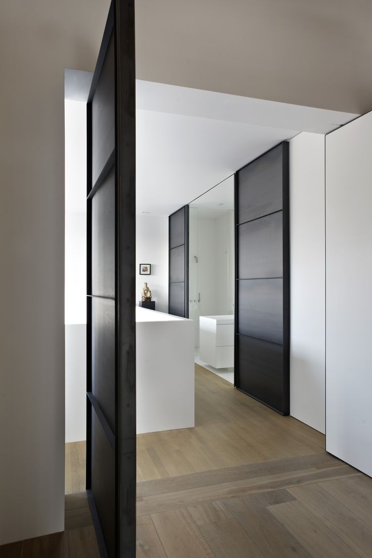 Industrial modern interior design, corridor to washroom. The Canal House renovated by HI-MACS® and designed by Witteveen Architects. Currently being featured on www.martynwhitedesigns.com