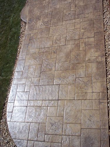 009 Stamped concrete....give a nicer look to your outdoor patio than just boring cement. Possibility!