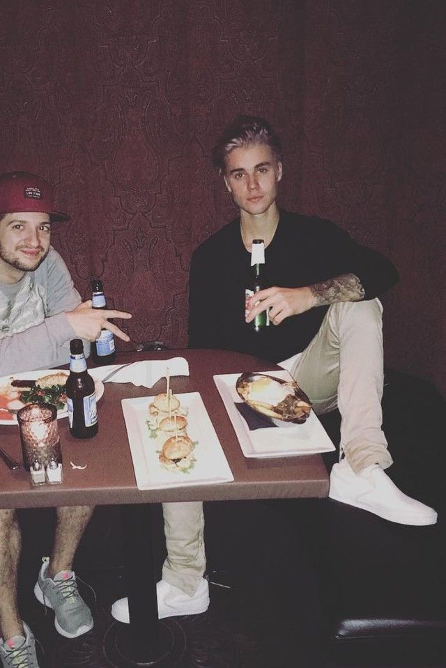 86dcd3c44b9614 Justin Bieber and Adidas NEO Label ended their partnership after two Justin  Bieber wearing Vans Classic Slip-On Shoes