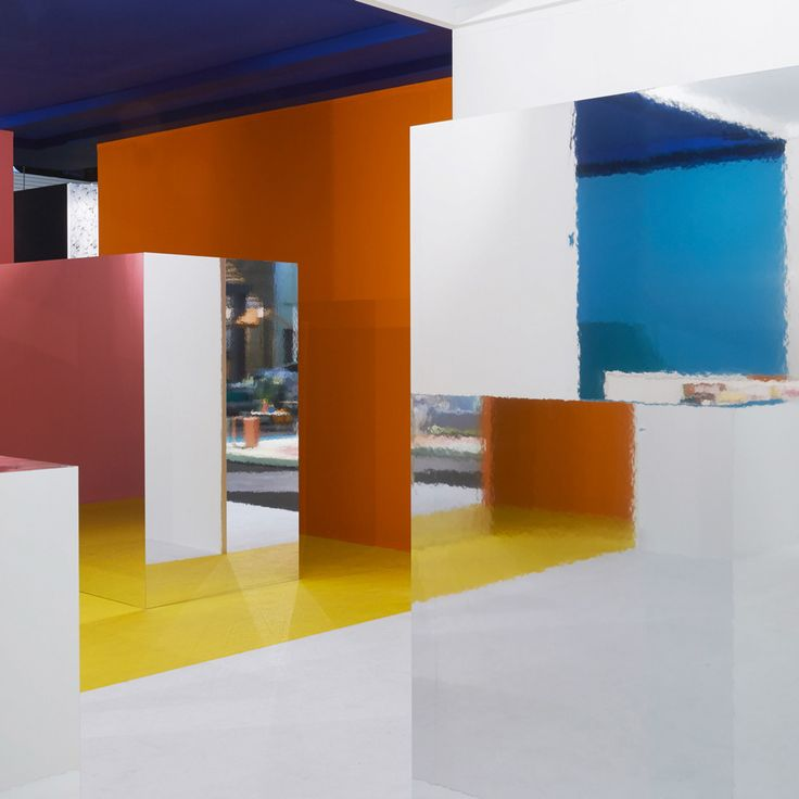 Dutch interior architecture studio i29 combined contrasting block colours and mirrored walls to create this pavilion for an annual design fair in Amsterdam