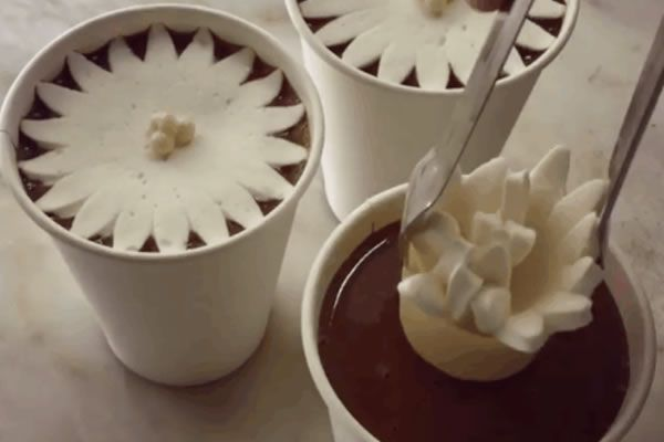 Marshmallow flower blossoming in hot chocolate by Dominique Ansel