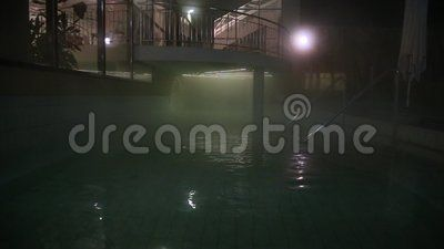 Thermal pool at night -  pavilion and entry in pool.