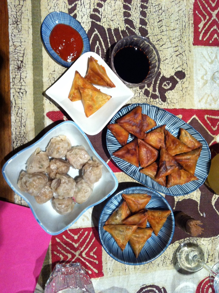 typical aperitif food on Reunion Island - samosas and bouchons