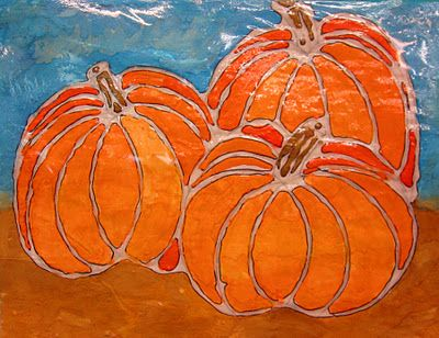 Glue pumpkins. Very Awesome! This lady has a great site filled with fantastic art projects... rundesroom.blogspot.com