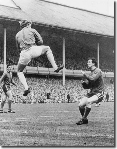 29th April 1967. Goalkeeper Gary Sprake performs a dangerous high kick toward Chelsea forward John Boyle, who was laid out after the impact.