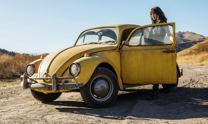 Bumblebee: First Photo from the Transformers Prequel  Paramount Pictures has released the first photo for the Transformers prequel Bumblebee.  The shot shows actress Hailee Steinfeld standing next to an older yellow VW bug version of Bumblebee. The Autobot is pretty darn dusty and dirty and that makes sense considering he's hanging out in a Californian junkyard according to the movie's synopsis. Check out the photo below:   Photo Credit: Jaimie Trueblood  2018 Paramount Pictures.  Continue…