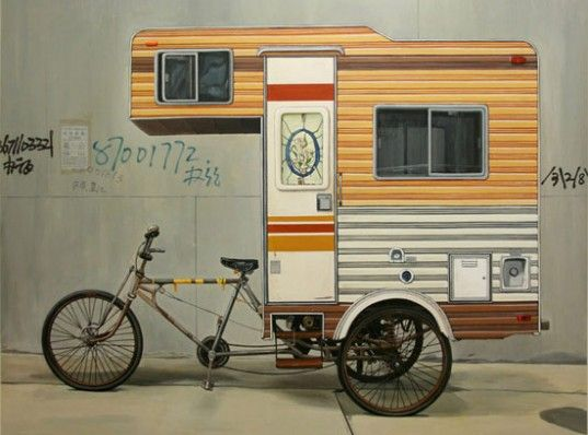 This pedal powered camper was constructed in April 2008 and is built for one. Attached to a burly tricycle frame made to haul goods, the cab-over easily sits on the back platform. Like a turtle shell this camper goes anywhere the owner can bike it.