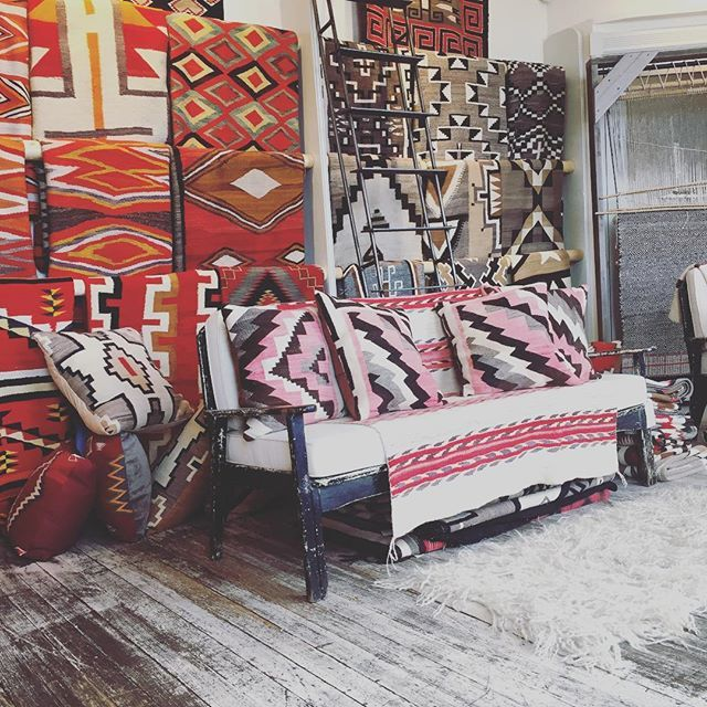 With all of our pillows made from salvaged Navajo textiles, our rug room is looking especially cozy these days.  #simplysantafe #Navajo #handwoven #newmexicotrue