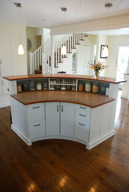 This island is part of our full house renovation designed for Kitchen island with round seating area
