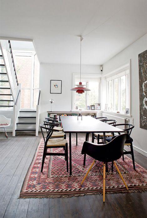 kilim carpet (plus eames and wegner chairs) in jean-ahlefeldt laurvig's bungalow, copenhagen (photo by andreas mikkel hansen)