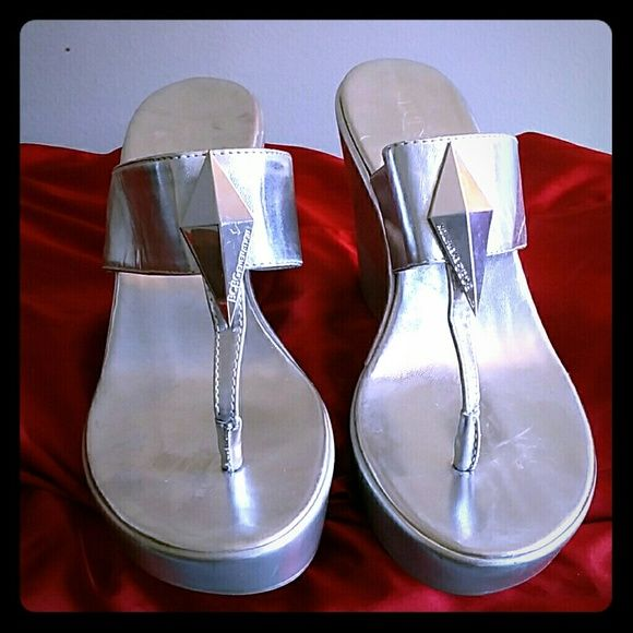 BCBG Wedge Sandals Popping Silver Wedge!  A few scratch marks on the back. BCBG Shoes Wedges