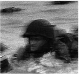 Who was the GI in the surf immortalized in Bob Capa's most famous D-Day photo?