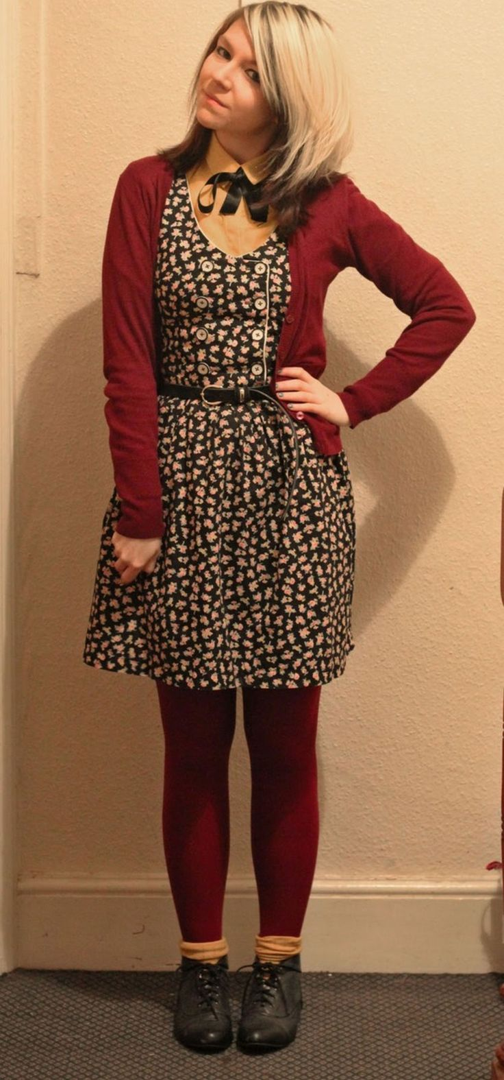 Dark red pantyhose layered with salmon socks on top + floral dress