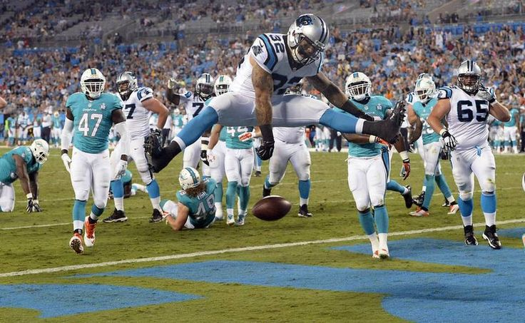 Carolina Panthers' Brandon Wegher (32) scores a touchdown past the Miami Dolphins defense in the third quarter during their preseason game at Bank of America Stadium on Saturday, August 22, 2015. The Panthers won, 31-30.
