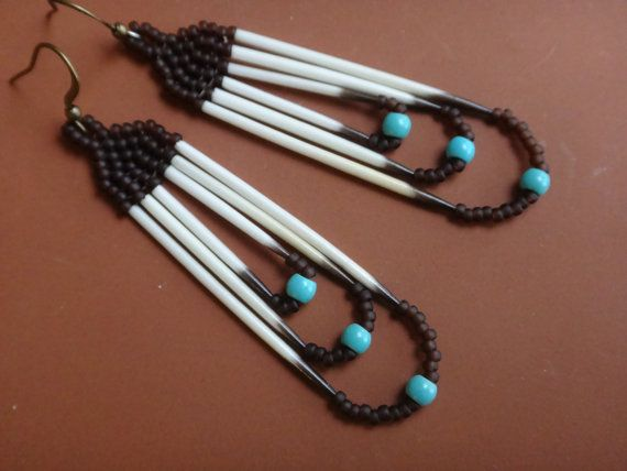 Native earrings of porcupine quills, Turquoise stones and japanese seed beads .    For the Native American, the porcupine is an innocent