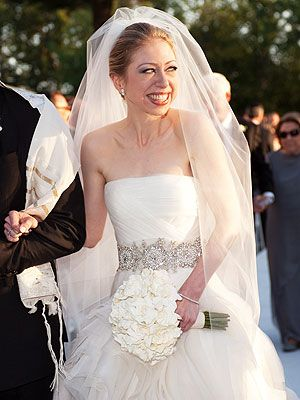 Chelsea Clinton glows in this Vera Wang gown with a shiny accent at her waist.
