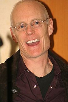 """Matt"" Frewer was born (1958) in Washington, D.C., the son of a Royal Canadian Navy officer. He was raised in Peterborough, Ontario. He is a Canadian American stage, TV and film actor. Acting since 1983, he is known for portraying the 1980s icon Max Headroom and the retired villain Moloch in the film adaptation of Watchmen."