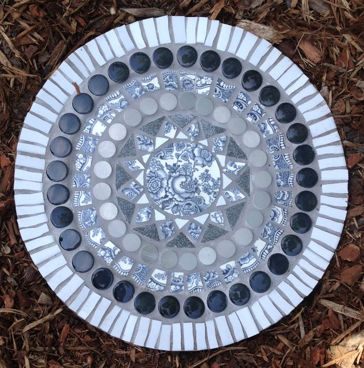 """This stone is called """"Shades of Grey I"""" and was made during a girlfriend weekend with my best friend, Tonja.  The transferware center focal tile is made out of a blue/grey Bristol pattern plate.  This stone now graces a garden in Lueneburg."""