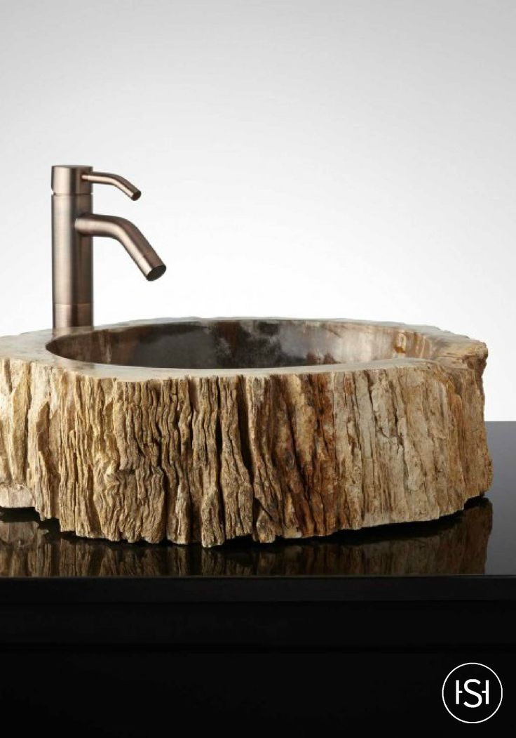 One-of-a-kind petrified wood vessel sinks give your bathroom a unique personality. To complete the earthy but modern look, pair this bath decor with a contemporary faucet.