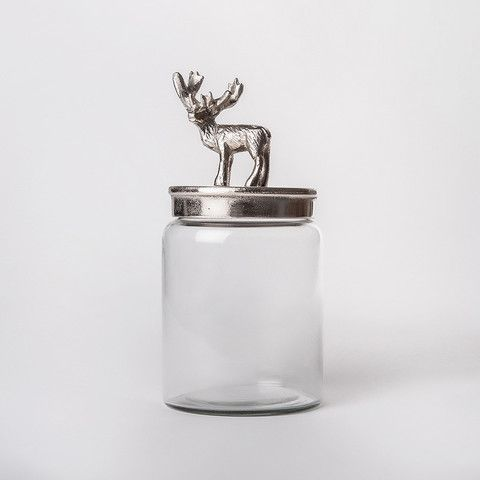 glass jar with silver lid with stag figurine