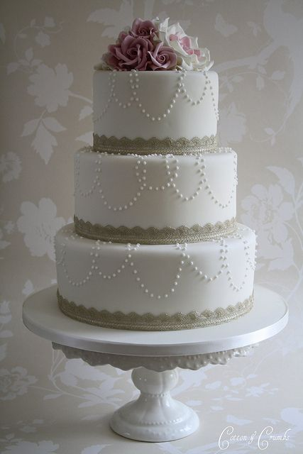 pearls and roses - simple yet stunning! Would like this one for our 25th wedding anniversary , we are going to renew vows