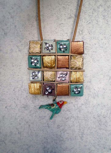 Folded Paper Jewelry.  Etsy shop is Coco Delay  http://www.etsy.com/shop/cocodelayinc?ref=seller_info