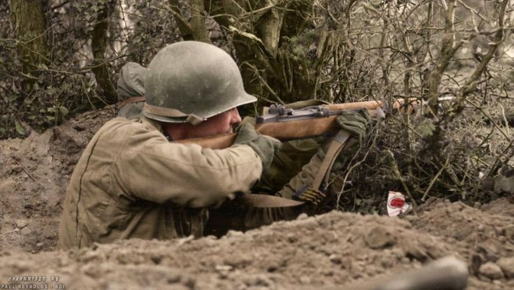 """Lucky Strike"" c. 1944. The United States was the only country to equip its troops with an auto-loading rifle as the standard infantry weapon of WWII. It gave their troops a tremendous advantage in firepower, and led General George Patton to call the M1 Garand, ""The greatest battle implement ever devised."" (Colorized by Paul Reynolds. Historic Military Photo Colourisations)"