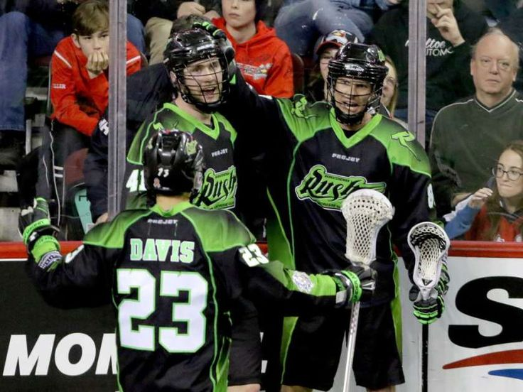 Saskatchewan Rush players Jarrett Davis, Dan Taylor and Zak Greer celebrate their overtime win against the Calgary Roughnecks in NLL action at the Scotiabank Saddledome in Calgary on Sunday.