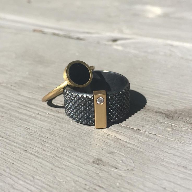 """WEEKEND / WISHES Just finished these two """"partners in crime"""" - love the way they complement each other. Have a wonderful weekend 💫 _____________ #jannikrogh #blackcopenhagen #gripring #ring #oxidized #silver #18kt #gold #onyx #diamond #jewlery #jewellery #smykker #accessories #design #scandinaviandesign #danish #copenhagen #weddingring"""