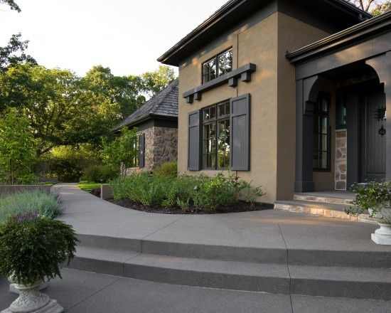 Stucco and stone black and brown home designs for Stucco home exterior designs