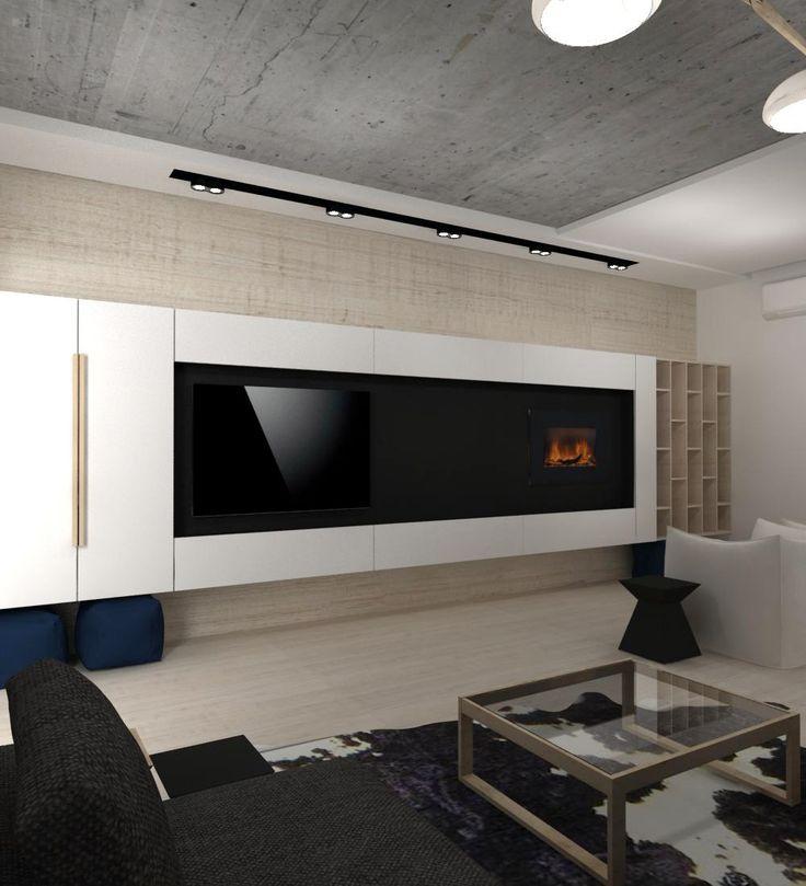 Шкаф в гостиной с камином и ТВ.
