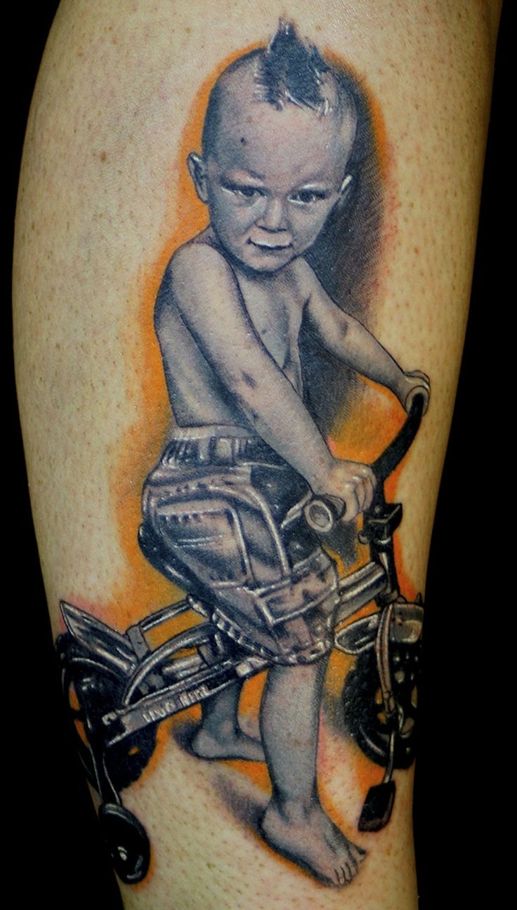 Baby portrait tattoo ideas - Child On Cycle Tattoo