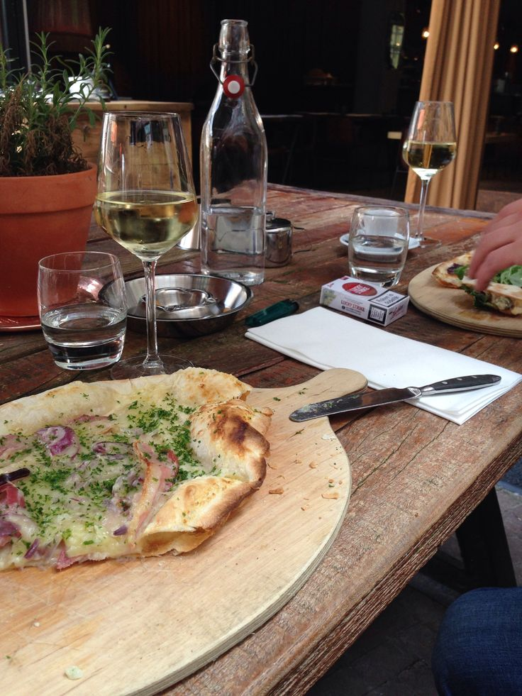 'Flamkuchen' with bacon, onion and cheese.  At hotel V in Amsterdam, a four star hotel at Nesplein.
