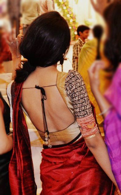 Low back gold and black saree blouse. #Saree | #IndianWedding