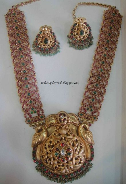 Latest Indian Gold and Diamond Jewellery Designs: Antique gold peacock design ruby haram set