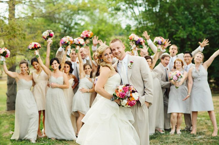 Such a cute way to get a formal photo of the bride and groom with a little fun from your wedding party!
