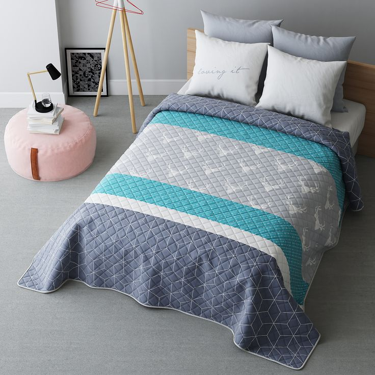Szara narzuta na łóżko w skandynawskim stylu