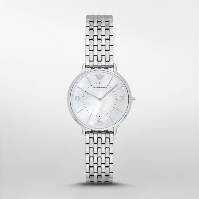 Dress Watch Sleek and feminine, this ladies' Emporio Armani watch gleams with a white mother-of-pearl dial, silver-tone indexes, and…