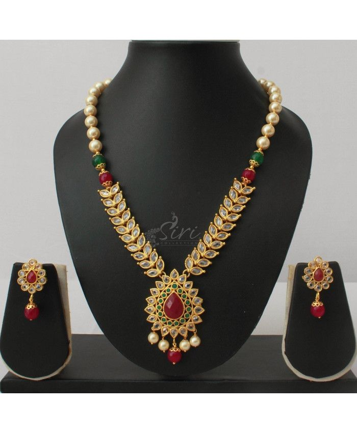 Polki Necklace Set in onyx and pearls maala. Length-17 , adjustable rings- 1 inch, pendant- 2 inch, earrings-1.25 inch approx