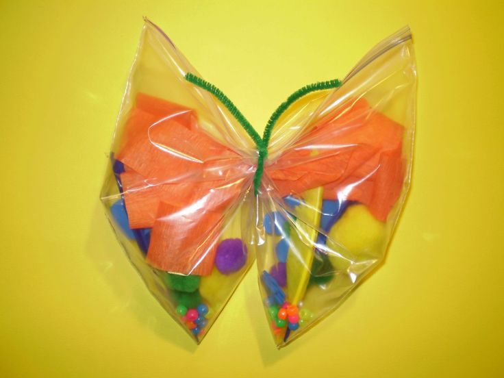 Plastic bag butterflies. Good craft for teaching patterns and textures with small children.  Gallon size plastic sealable bag, pipe cleaner, and colorful miscellaneous items to fill inside.  Ideas include: crete paper, ribbon, scrap fabric, sprinkles, beads, pompoms, foam objects, colored feathers, colored tissue paper, crumpled wrapping paper.