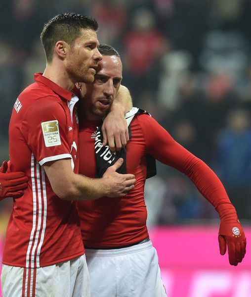 Bayern Munich's Spanish midfielder Xabi Alonso (L) embraces Bayern Munich's French midfielder Franck Ribery the German first division Bundesliga football match between FC Bayern Munich and Bayer 04 Leverkusen in Munich, southern Germany, on November 26, 2016.  / AFP / CHRISTOF STACHE / RESTRICTIONS: DURING MATCH TIME: DFL RULES TO LIMIT THE ONLINE USAGE TO 15 PICTURES PER MATCH AND FORBID IMAGE SEQUENCES TO SIMULATE VIDEO. == RESTRICTED TO EDITORIAL USE == FOR FURTHER QUERIES PLEASE CONTACT…
