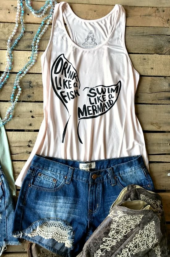 """Our Swim Like A Mermaid Racerback Tank is a racerback tank with scoop neckline and with """"Drink like a fish, Swim like a mermaid"""" on the front in a mermaid tail. #southernfriedchics"""