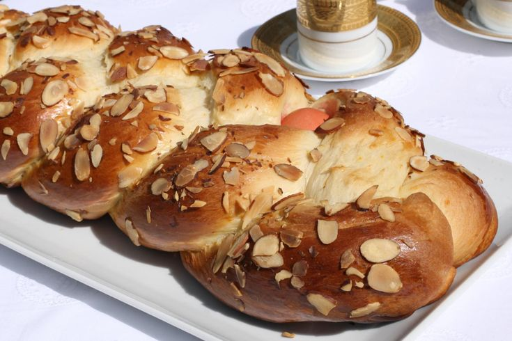 Greek Easter Bread (Tsoureki)   Tsoureki, a sweet yeast bread made of eggs, milk, and butter, is a staple during Greek Easter. The three-strand braid symbolizes the Holy Trinity, while the red-dyed hard-boiled egg braided into the dough symbolizes the blood of Christ. The bread is delicious and keeps for several days, but eat that double-cooked egg at your own risk.